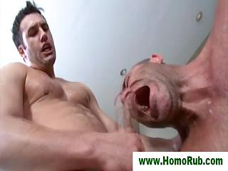 Muscular masseuse taking a facial