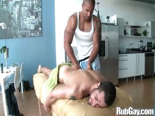 Tired gay rugby player gets a nice relaxing knead beyond everything his back increased by ass from a masseur stud