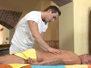Cute twink gets a lusty rub-down distance from impressive gay dude